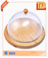 Round wooden chopping board with acrylic cover